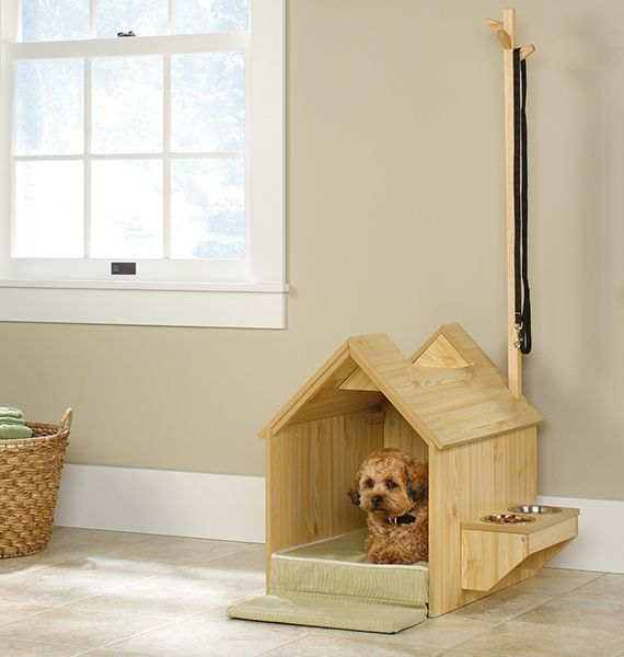 Inside Dog House By Sauder, $169.99 This lovely pine indoor dog house provides the perfect oasis for your small or medium size pooch to retire to after a long day of playing. The house also includes a feeder area, supply space, and a place to hang leashes & other pup accessories!