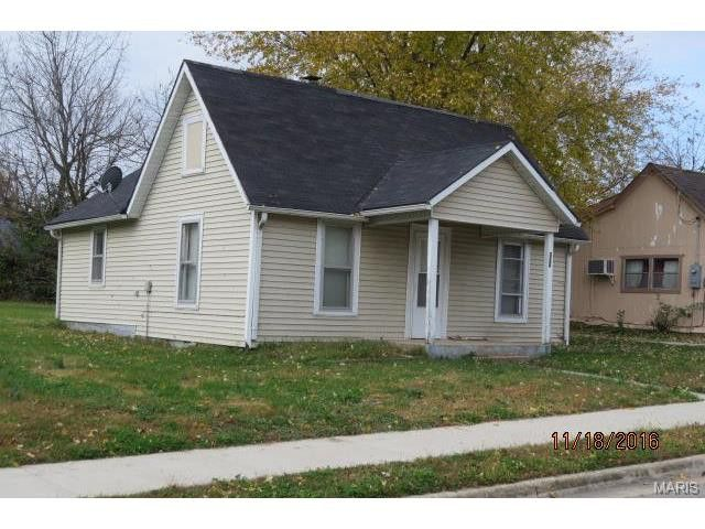 Cute bungalow has had lots of updates in recent years. Extra insulation as been added to this home. Natural gas furnace, totally rewired in 2014. Shingles are approximately 8 years old, vinyl siding, fresh paint and newer carpet in living room and bedrooms. Storm doors are newer in Lebanon MO