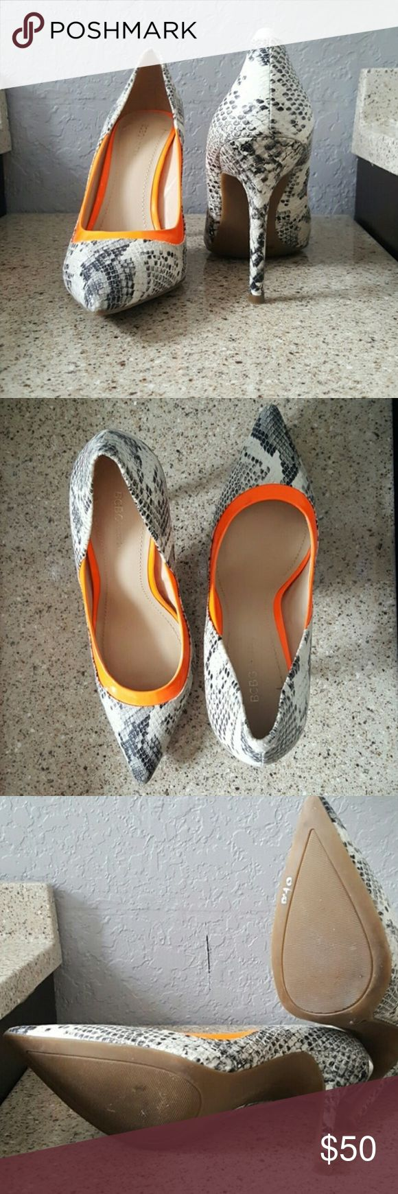 """BCBG snakeskin and orange heels Has the perfect heel height to give off a flirty classy incline. Sleek look with an orange accent to make your outfit pop! Can be paired with professional attire, night out attire, semi-casual brunch/lunch attire, etc. 3.75"""" heel with flat platform. BCBGeneration. Never been worn! BCBGeneration Shoes Heels"""