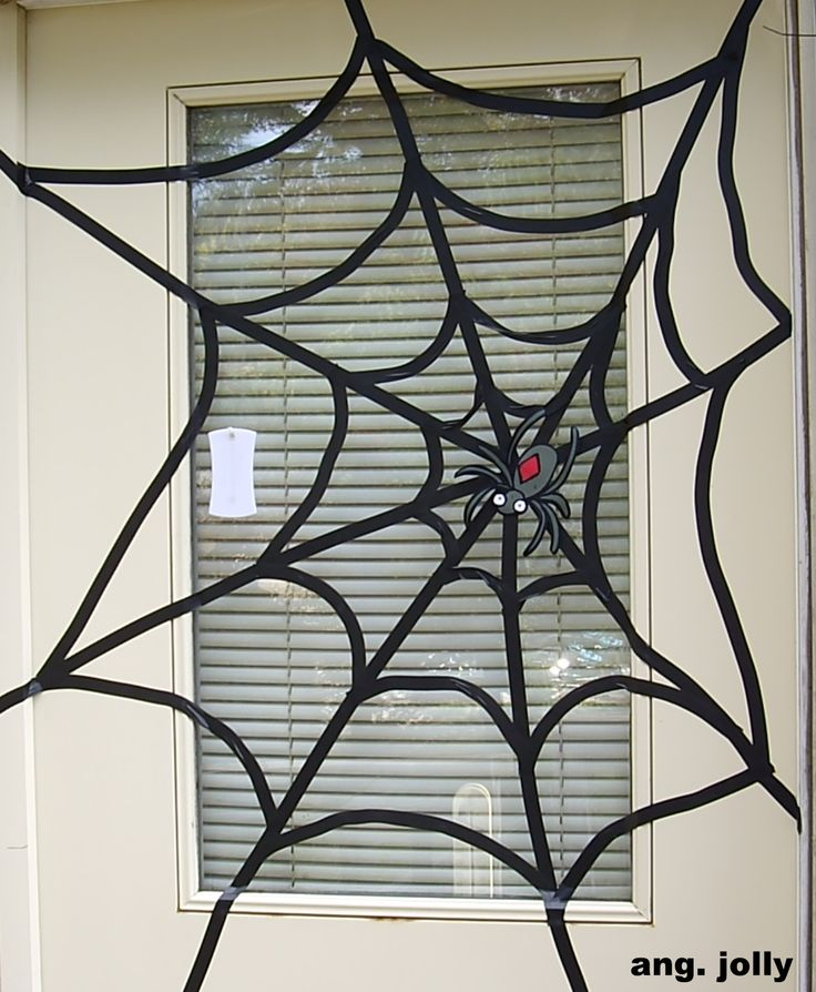 electrical tape spider web with paper spider