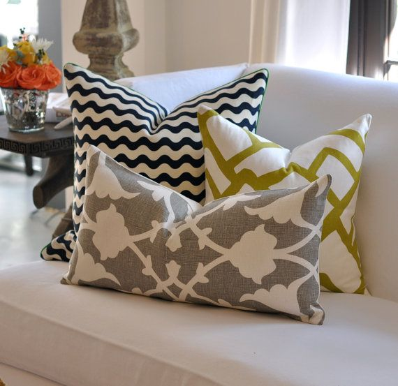 These look so chic on a sleek white couch!! They give it a nice comforting punch of detail making the space cozy and inviting, totally visible in my future space with Joe.: Livingroom, Living Room, White Couch, Mixed Pattern, Pillows
