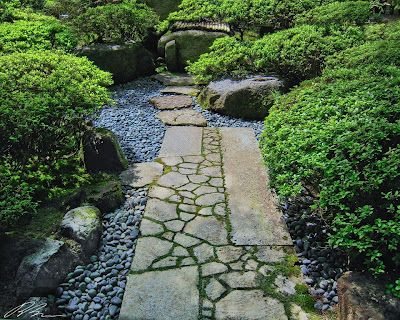 Rock (or reclaimed concrete) path with an interesting mix of rectangular slabs filled with broken bits.
