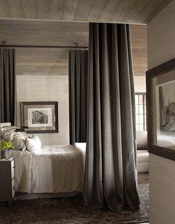 An Alabama Lake House Love the use of curtains around the bed. Gives the appearance of a 4 poster bed or canopy. Could use track on the ceiling so the curtains slide easily.