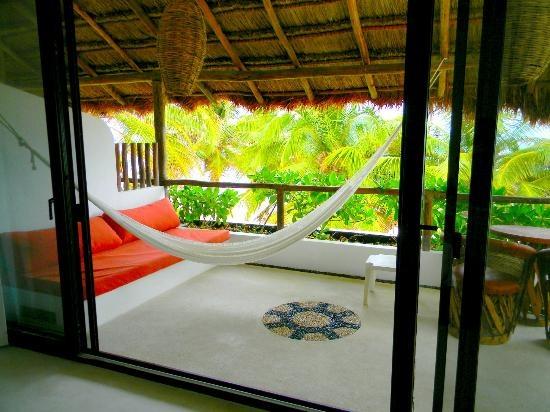 Cabanas Tulum has AC and right on beach. $129/nt.