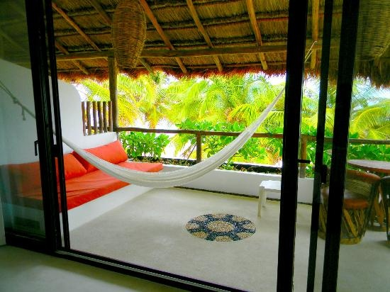 Cabanas Tulum has AC and right on beach. $129/nt.