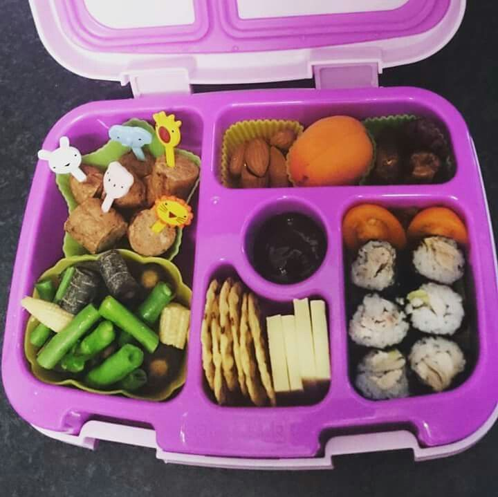 Beef and vegetable sausage, beans, baby corn, purple carrot, wholegrain rice crackers, cheddar cheese, chicken and avocado mini sushi, yellow grape tomato, dates, apricot, almonds, bbq sauce.