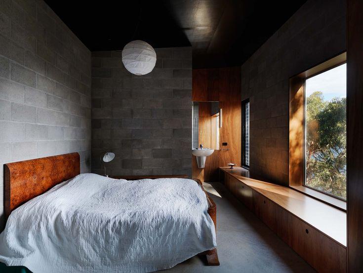 Bedroom and unique aperture into the bush.