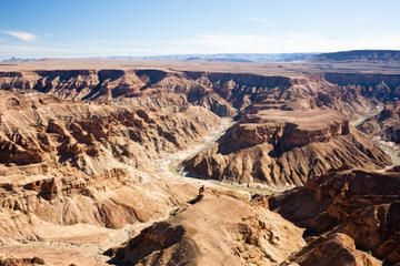 Discover the wild and diverse beauty of southern Namibia on this 7-day, small-group tour from Windhoek. Experience the savannas of the Kalahari Desert, and walk the rim of Fish River Canyon, the world's second largest canyon. Marvel at the famous Sossusvlei dunes and make your way through a ravine at Sesriem Canyon. Learn about Quiver Tree Forest and the wildlife that roam the Namib Desert plains.