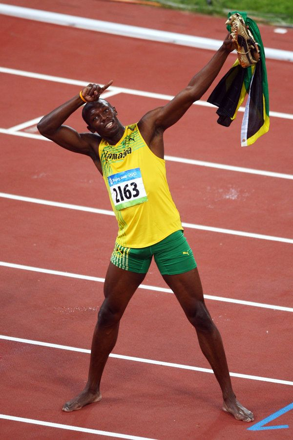 Usain Bolt of Jamaica celebrates winning the Men's 100m Final and the gold medal at the National Stadium on Day 8 of the Beijing 2008 Olympic Games on August 16, 2008 in Beijing, China. Bolt finished the event in first place with a time of 9.69, a new World Record. (Photo by Mike Hewitt/Getty Images)