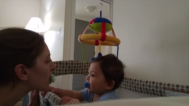 Little baby Jack plays the most adorable game with his mom. Watch them repeatedly switch pacifiers back and forth that will most definitely put a smile on your face. Baby exchanges pacifiers with mommy.
