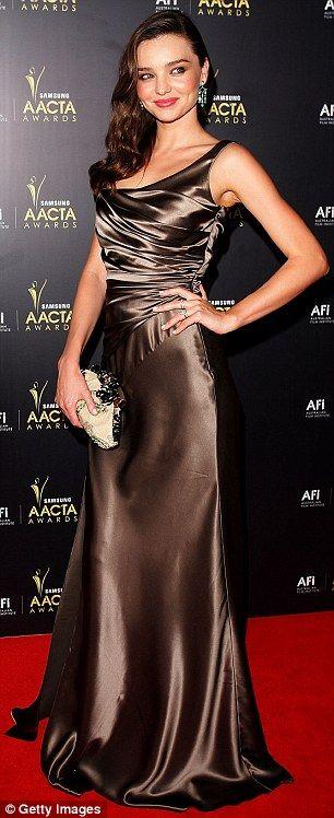 Model Miranda Kerr wears a bronze Collette Dinnigan dress   From Daily Mail UK