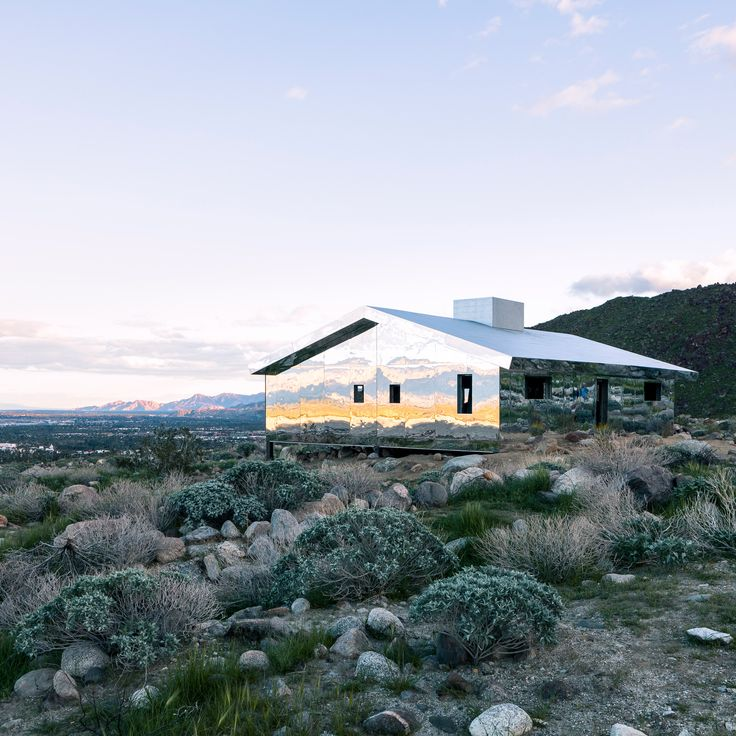 American artist Doug Aitken has built a small house-shaped structure clad top to bottom in mirrors in the desert outside Palm Springs.