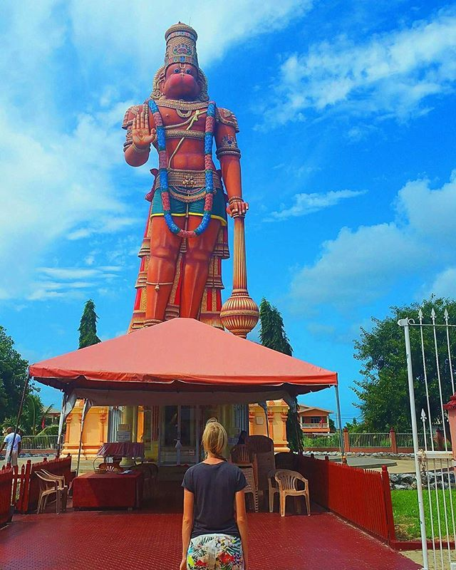 A magnificent 85-foot tall statue of the Hindu god, Lord Hanuman located in the village of Carapichaima, #Trinidad. 🌟 Itss the largest #Hanuman murti outside India.🗺🌏 #paulinaontheroad #trinidadandtobago #murti #hindutemple #hindustan #hinduculture #hinduarchitecture #triniscene #tobago #caribbeanlife #caribeando #hikinggirl #triniscene #trinistyle #tobago #westindies #westindies_nature #ig_trinidadtobago #ig_trinidadandtobago #FemaleTravelBlogger #wearetravelgirls