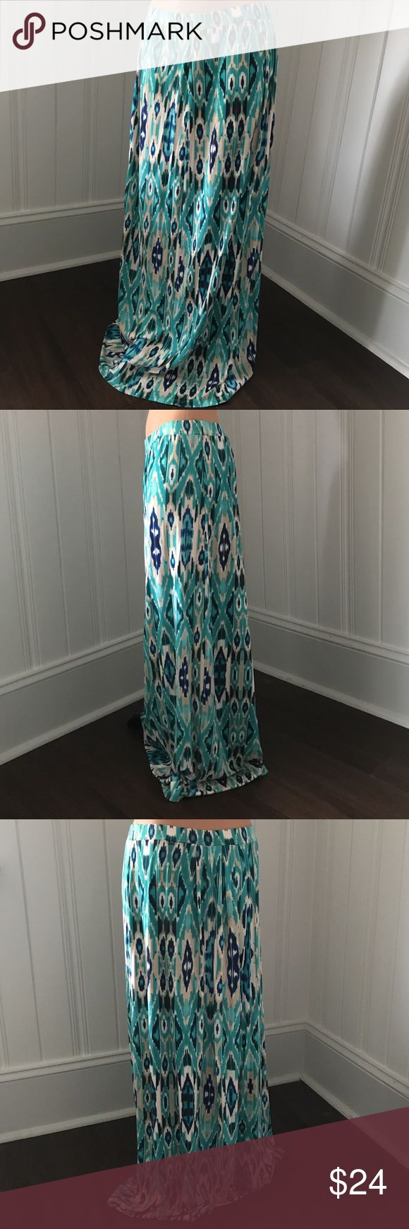 Cynthia Rowley Ikat Blue Teal Maxi Skirt M Cynthia Rowley Ikat Blue Teal Maxi Skirt M  Gorgeous jersey feel skirt! Looks great with a basic tee! Casual and comfy! Great Condition!!  Size - Medium  Approx Measurements: Waist - 29in 39.5in Cynthia Rowley Skirts Maxi