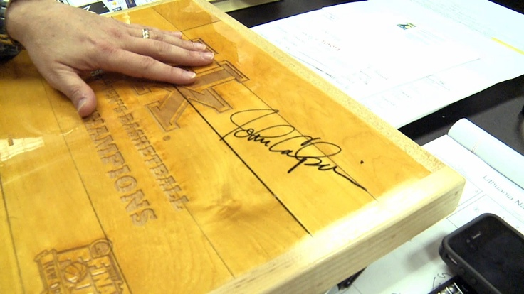 300 pieces of the #NCAA Final Four floor on which the University of Kentucky men's team won its 8th national championship were auctioned to benefit the Children's Hospital Foundation. The rare piece pictured was signed by coach John Calipari. #MarchMadness