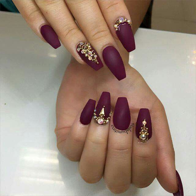 Matte acrylic nails with gold studs and rhinestones