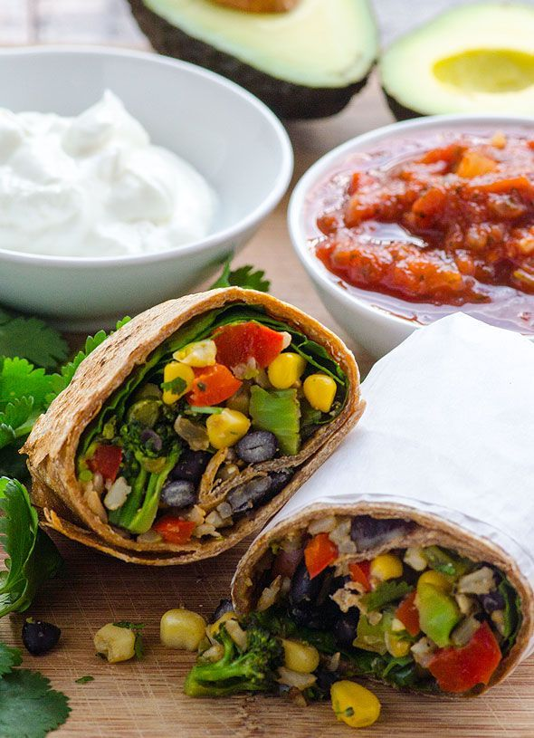 Clean Eating Broccoli and Spinach Burritos -- You can make burritos wholesome (even the tortillas), refrigerate or freeze for easy dinner or lunch on the go, and kids love them too! #vegan