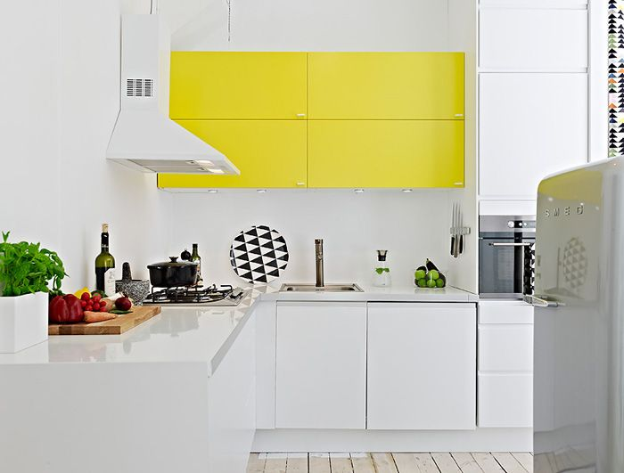 cute white kitchen with yellow upper cabinets
