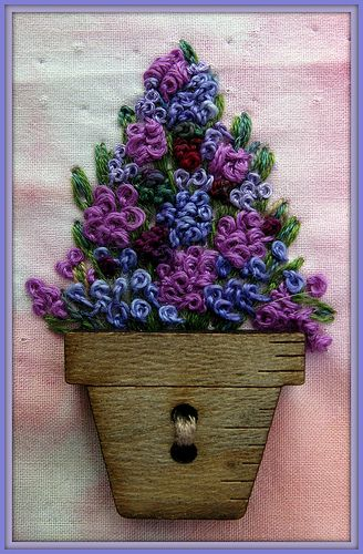 No directions but easy to figure out. Flower pot button with French knots.