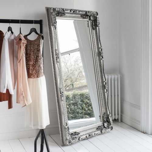 Buy the Carved Louis Leaner Mirror in Silver with free delivery from Turnbull and Thomas