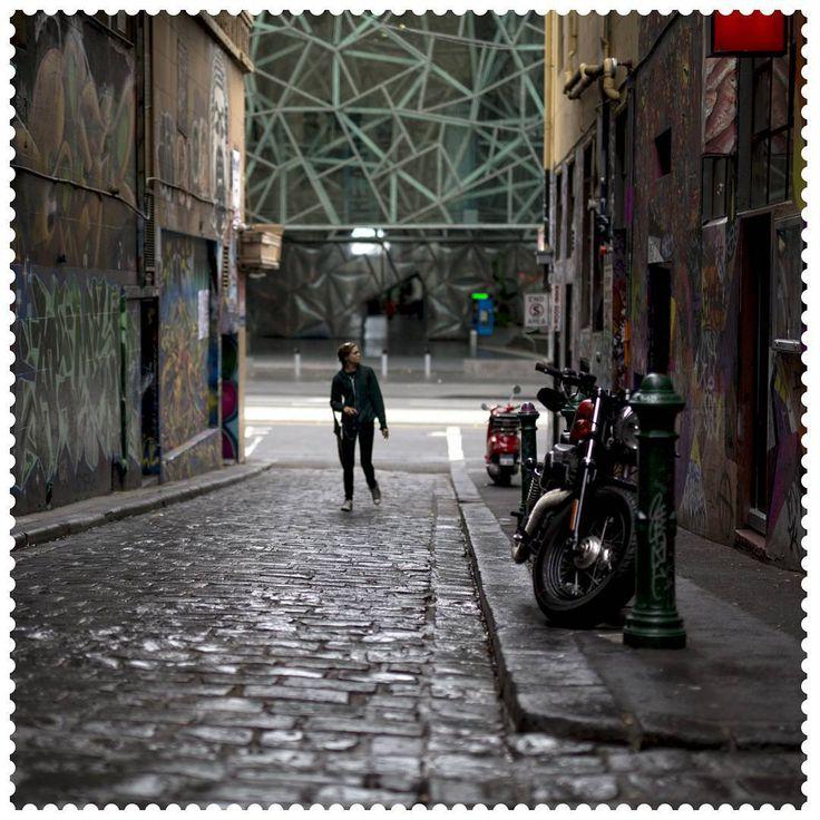 Street art viewing in Melbourne, 3000. #AustraliaConnected, #Australia, #Victoria, #Melbourne, #postcode3000, #HosierLane, #Graffiti, #Cobblestone.