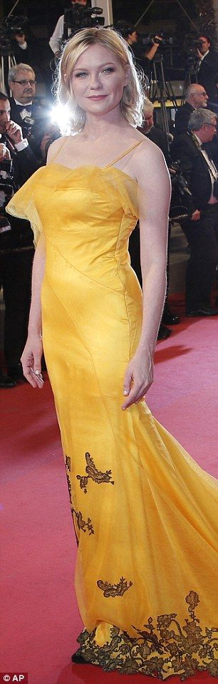 Kirsten Dunst exudes glamour in a vibrant canary yellow gown at the Neon Demon premiere in Cannes | Daily Mail Online