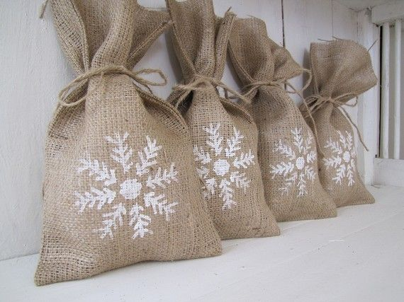 Snowflake Burlap Gift Bags.  These are for sale, but really more inspiration than anything.  I'm sure I could buy the plain burlap bags and stencil on any design.  Adorable.