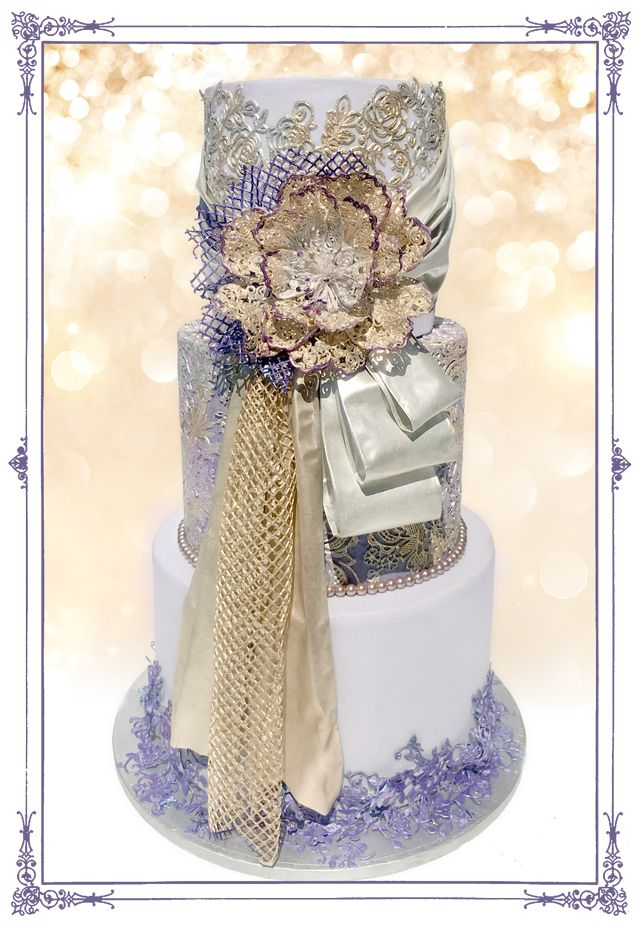 * The Gold & Purple experience ** Many Crystal Candy products were used in the creation of this cake: *** Crystal Lace Signature Blend for all the edible lace Go to our YouTube video to see how to make your own lace with ease:https://www.youtube.com/watch?v=4mZervGk-ZE *** Edible FabricArt for all the drapes *** Angels Aura Pearlescent Lustre for coloring the fondant *** Glitterati Gold & Mercury Diamond lustre for the edible lace *** Bastille Vivid Diamond lustre for the lace at the base…