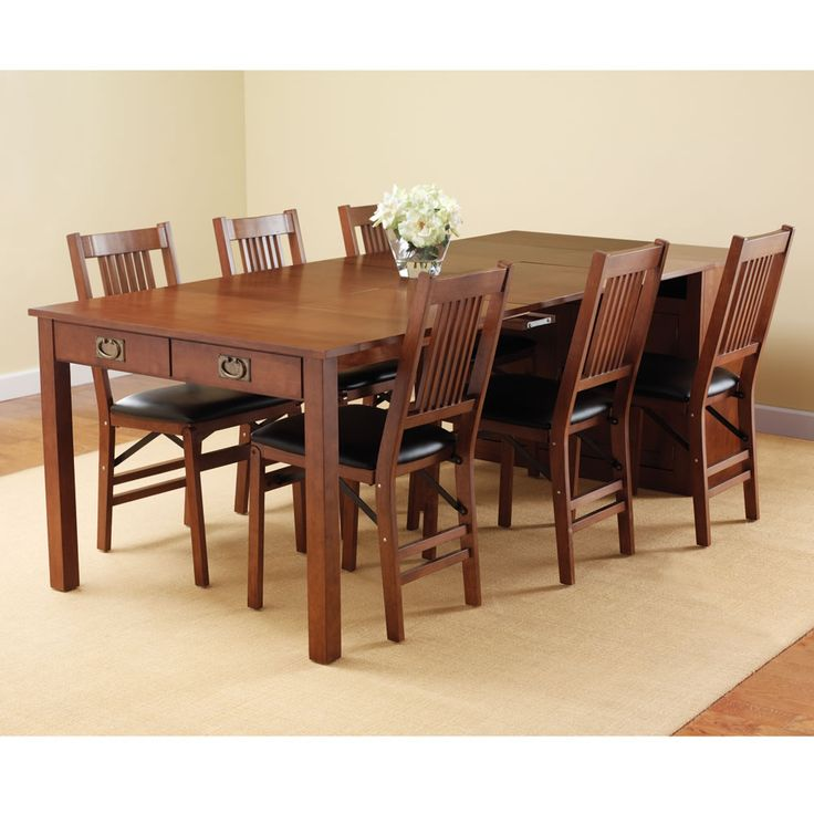 The expanding dining table hutch hammacher schlemmer for Dining room table 6 person