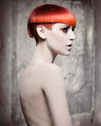 Half shaved and layered avant-garde hairstyle