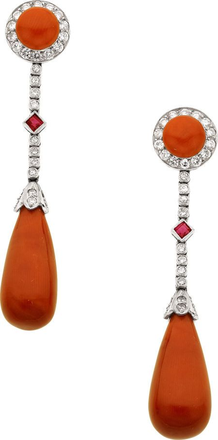 Coral, Diamond, Ruby, Platinum Earrings  The earrings feature coral cabochons measuring 6.60 - 6.70 mm, enhanced by full-cut diamonds weighing a total of approximately 0.65 carat, accented by square-shaped rubies, supporting teardrop-shaped coral cabochons measuring 8.70 - 9.50 x 19.50 mm, set in platinu