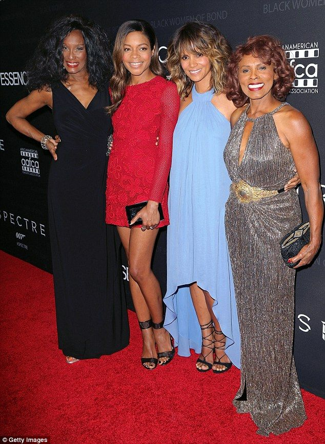 Honored: Bond girls Trina Parks, far left, and Gloria Hendry, far right,  joined Naomie Harris (second left) and Halle Berry (second right) at the African American Film Critics Association in Hollywood on Tuesday