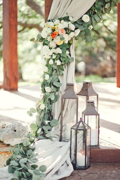 florals and greenery draping the ceremony spot