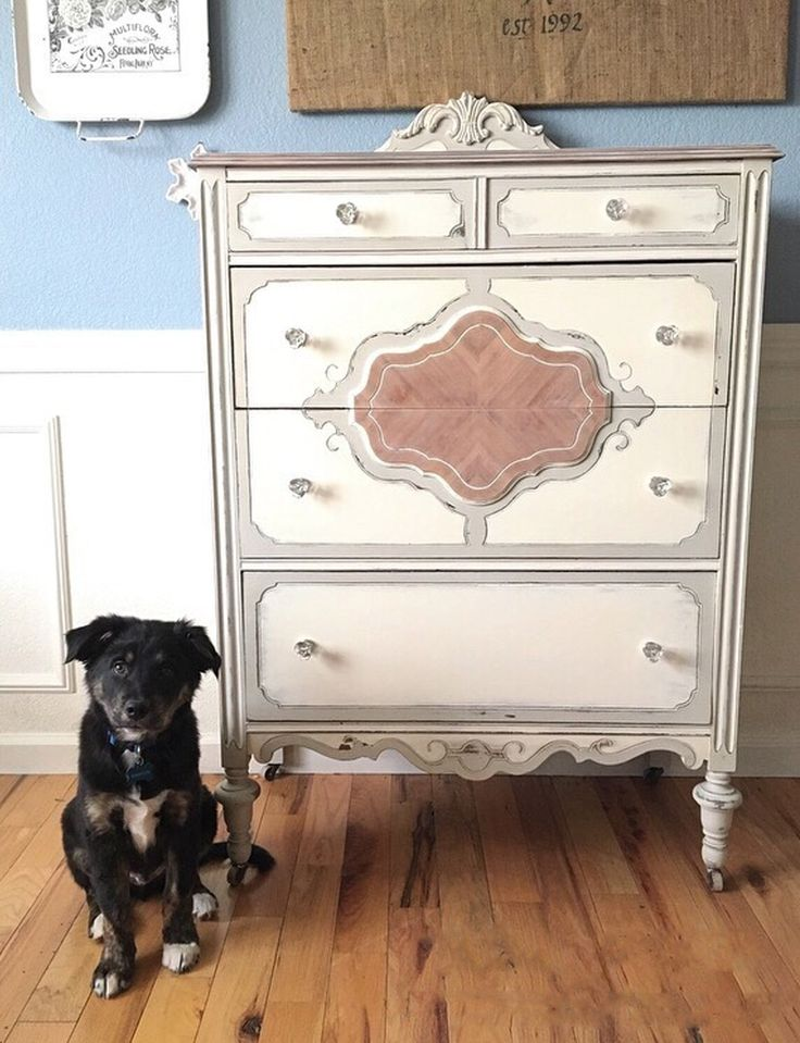 Beautiful refinished solid wood chest of drawers painted in neutral colors.