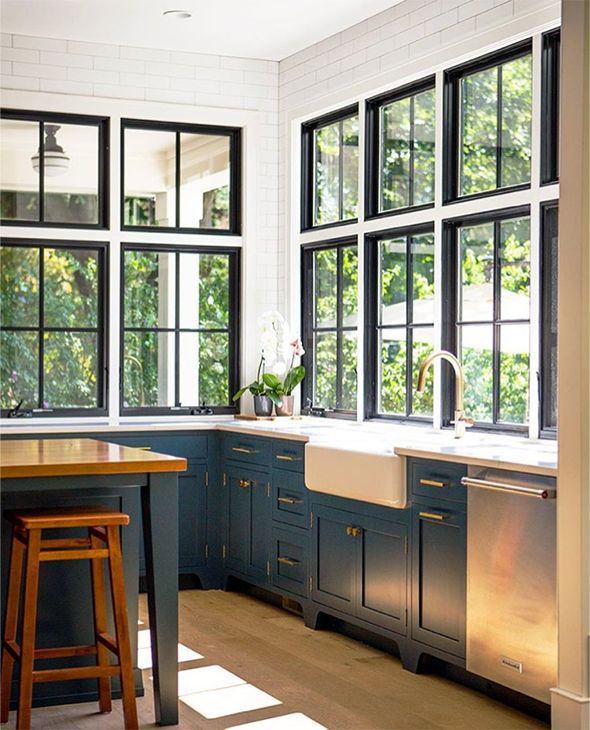 blue and white kitchen with big windows