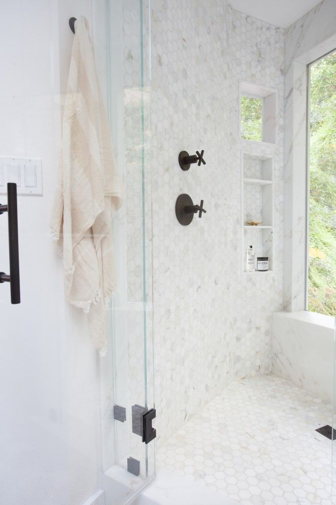 hexagon marble tile shower and dark fixtures
