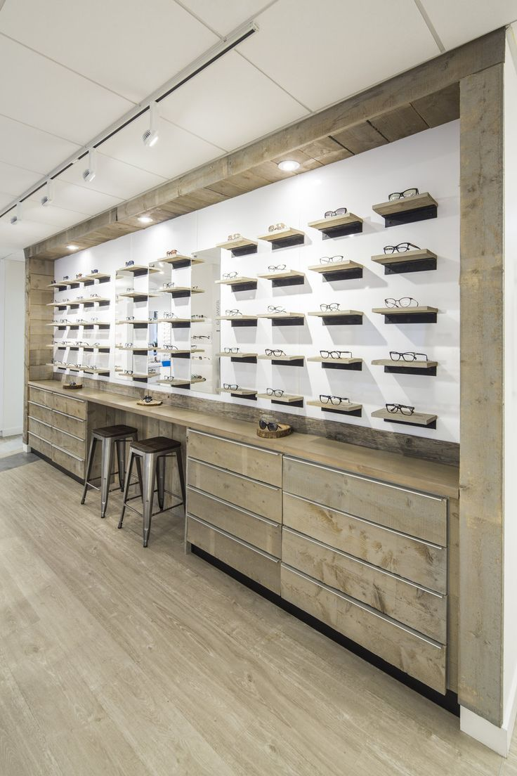 Spot Eyewear inside Insight Optometry Clinic. Rustic reclaimed wood try-on bar with black iron brackets and glossy white backdrop.  By and Large Studios - Halifax.