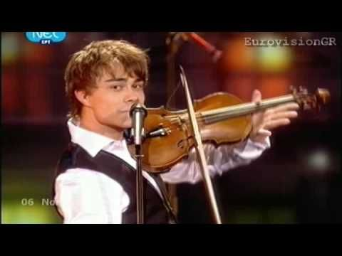 Fairytale - Alexander Rybak - The winner of the 2009 Eurovision song contest. I actually really like this song. It is sung and written by Alexander Rybak, based off Norwegian folk music, which makes sense, since was representing Norway. The official music video for this is kinda boring, actually, no matter how much I like this song. Honestly, he looks a bit like a smiling frog, but not in a bad way. The dancers in the background are cool too.