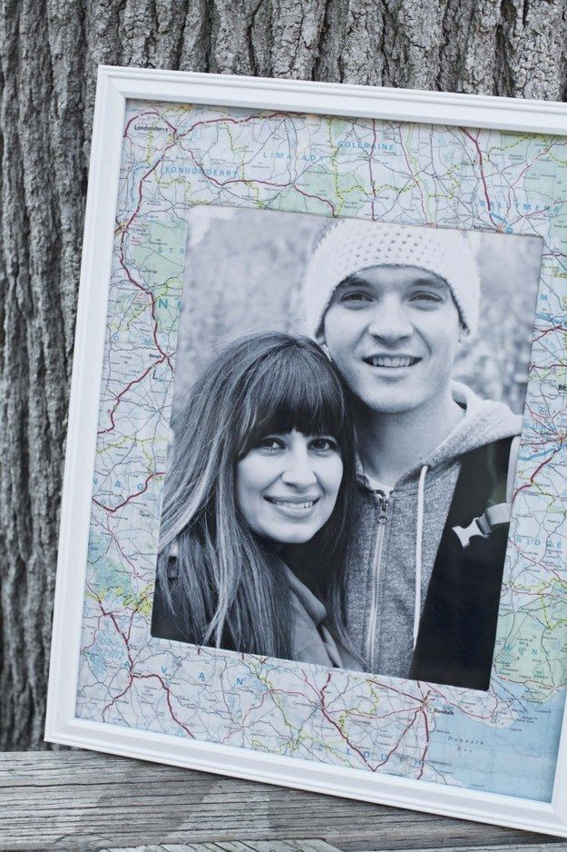 Cover the mat of a photo frame with a map of the state or country you visited.