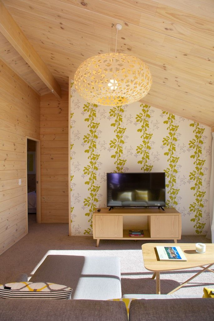 Family room with fabulous wallpaper feature wall in new Lockwood show home