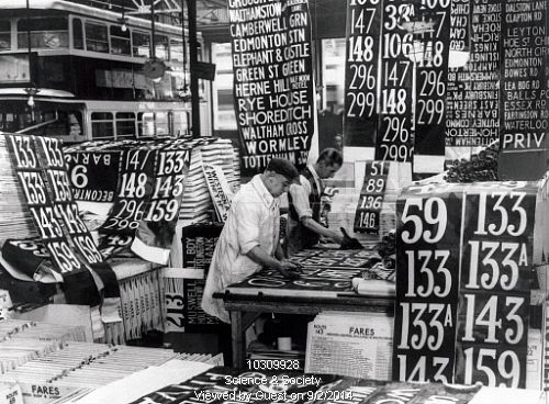 Preparing new London bus numbers, 28 September 1934.