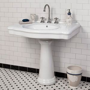 classic bathroom with white and black subway tile, octogonal floor tile