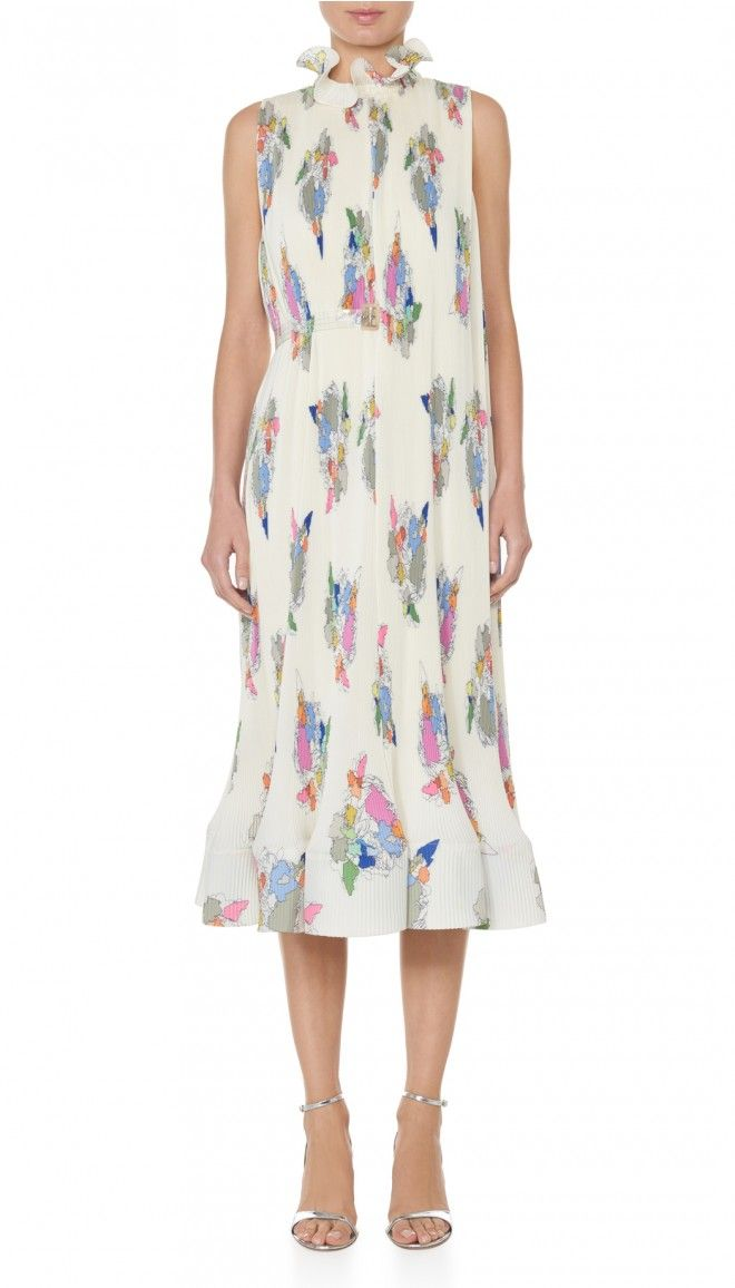 A Runway favorite, this ultra-feminine dress will be the Spring and Summer go-to of the season. Delicate pleating throughout and ruffle details at the collar and hem accentuate the style with a blooming effect. Colorful prints take on the shape of the boroughs of New York. A removeable PVC belt creates a plethora of styling possibilities. Slight open back with ribbon closure can be worn loose, knotted, or in a bow. Fully lined. 100% Polyester. Professional Dry Clean Only.Style Number…