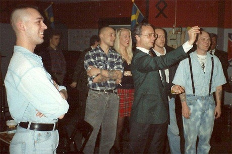 The Swedish king throwing darts with members of Stockholm Skins at Fryshuset Stockholm