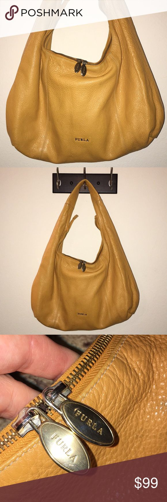 """FURLA Mustard Yellow designer Hobo Shoulder Bag This is a large FURLA Mustard Yellow designer Hobo Shoulder Bag in gently used condition! Clean inside and out! Top zip! Genuine Leather! Measures 19""""x12"""", I ship fast! Happy poshing friends! Furla Bags Hobos"""