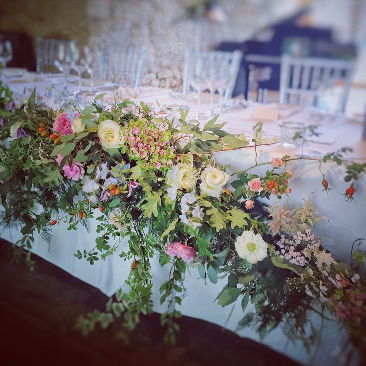 Top table wedding garland design at Notley Abbey.