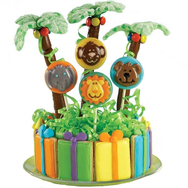Happy Habitat Cookies and Candy - This fanciful tableau is a party in the making. Surround a foam base with cookies wrapped in color flow icing. Add Animals Cookie Candy Mold lollipops and palm trees made from readymade candies.