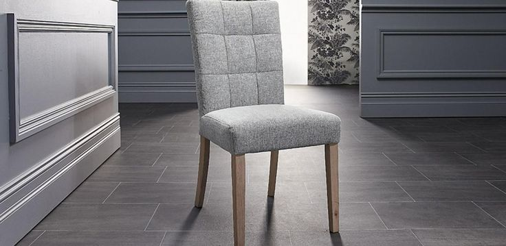 A comfortable fabric seat with rubber wood legs