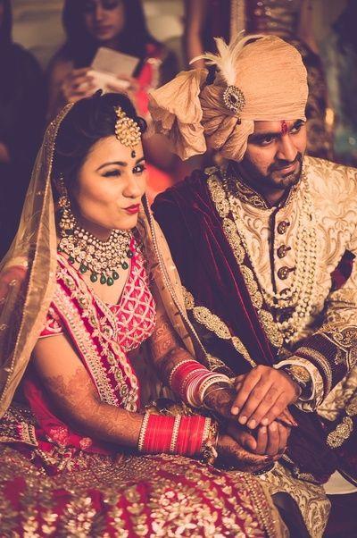 #couple #love #swag #indiangroom #indianbride #weddingwear lehenga #redlehenga #weddingjewellery #wedding #indianwedding