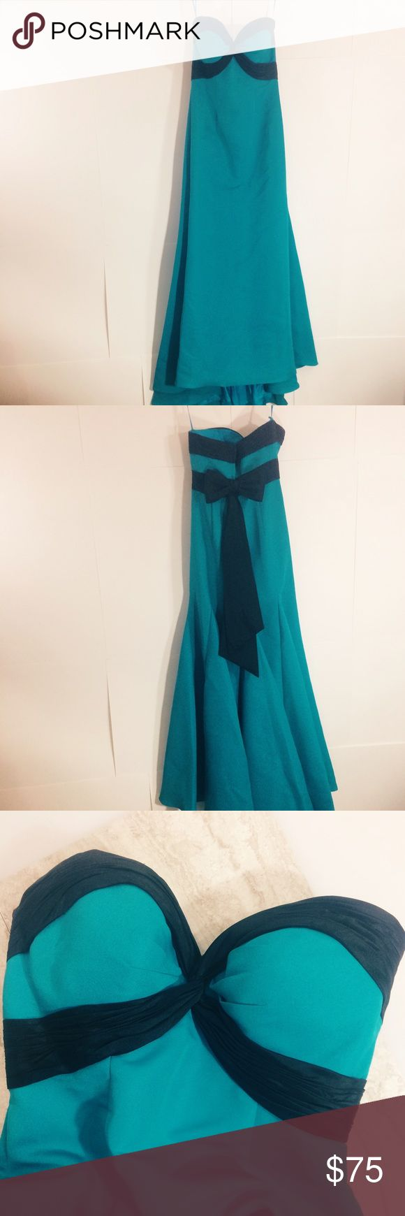 Gorgeous Jovani  trumpet gown Beautiful teal and black trumpet gown with zip up back, bony throughout bodice, molded cups, trumpet fit and flare look, large bow in back. Amazing dress!  Some spots are visible upon close examination, adding photos in another listing. Have not tried to dry clean yet, could come out that way. Priced accordingly, this dress is so well-made and gorgeously flattering! Open to reasonable offers, no trades, bundle to save! Jovani Dresses Prom